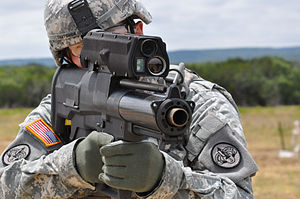 XM25 CDTE - A soldier aims an XM25 weapon system at Aberdeen Test Center