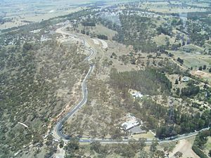 Mount Panorama Circuit - The run down the mountain, looking from Forrest's Elbow to Skyline and beyond.