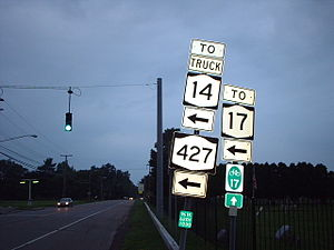 New York State Route 427 - 2004 photo of signage at the intersection of Cedar Street and Maple Avenue in Southport. Until 1978, NY 427 continued straight and NY 379 began to the left.