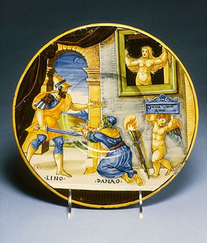 """Lynceus - Hypermnestra watching Lynceus take her father's crown; Cupid holds up the motto """"Love Conquers All"""" (maiolica plate, 1537, by Francesco Xanto Avelli)"""