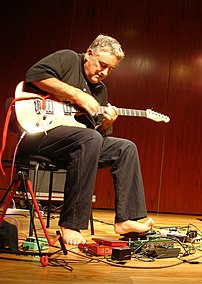 Fred Frith performing with (off camera) Larry ...