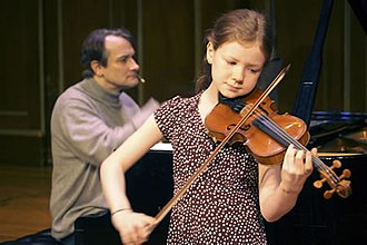 From the Top - Pianist Christopher O'Riley accompanies 10-year-old violinist Alice Ivy-Pemberton as she plays a Bartók rhapsody for NPR's From the Top.