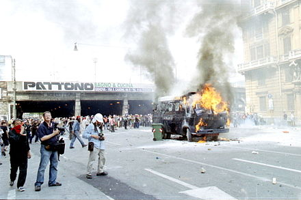 Protesters try to stop members of the G8 from attending the summit during the 27th G8 summit in Genoa, Italy by burning vehicles on the main route to the summit. Genova-G8 2001-Incidenti a Corso Torino.jpg