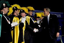 A photograph of President George Bush shaking hands with fourth degree knights.