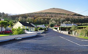 Ballyhoura Mountains - Glenosheen Village The road into Glenosheen, viewed from the R512 junction, with the Ballyhoura mountain range in the background.