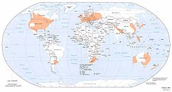 Areas worldwide where tornadoes are most likely, indicated by orange shading.
