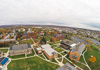 Gettysburg College - The campus as seen from a GoPro mounted to a drone.  From left to right in the foreground: College Union Building, Plank Gym, Master's Hall, Science Center Complex.