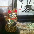Golden maneki neko with coins at base - 2014.jpg