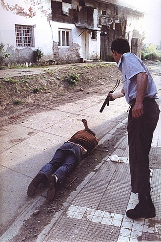 Bosnian War - Goran Jelisić shooting at a Bosnian Muslim victim in Brčko in 1992