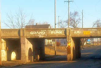 Grand Funk Railroad - A Grand Trunk Western Railroad bridge in the band's hometown of Flint, Michigan, that was vandalized to instead show their name, as well as the first names of founding members Mark Farner and Don Brewer; and early 1980s bassist Dennis Bellinger.