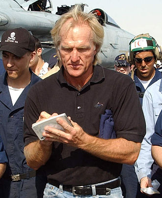 Professional golfer - Professional golfer Greg Norman signs autographs for sailors as he visits the conventionally powered aircraft carrier USS John F. Kennedy.