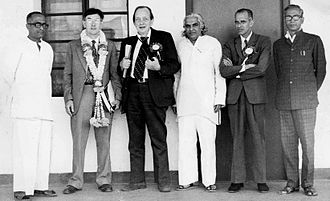 Arthur Llewellyn Basham - Group Photograph showing T. V. Venkatachala Sastry (first from right) with A. L. Basham (third from left) during a meet at University of Mysore.