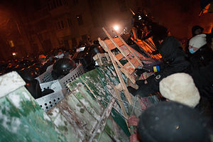Groups of protesters face a deployment of riot police during the evacuation operations. Kiev. December 10, 2013-2.jpg