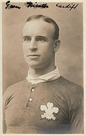 Portrait of Nicholls wearing his Wales top, which includes the Prince of Wales feathers on the left breast