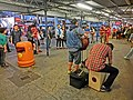 HK TST Star Ferry Piers street music The Flame Live evening May-2013 orange collection bin.JPG