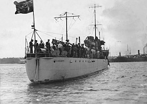 HMAS Parramatta (D55) - Stern view of Parramatta with crew on deck. The ship is flying the Australian National Flag from the stern instead of a naval ensign.