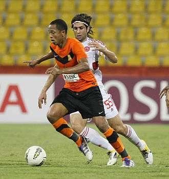 Hadi Aghily - Hadi Aghily as Al-Arabi captain with Cabore