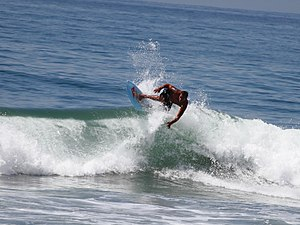 Sunset Beach, California - A surfer rides the break at Sunset Beach