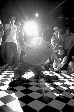 A Close Up Black And White Photo Of Male Hip Hop Dancer Surrounded