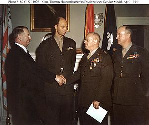 Thomas Holcomb - General Holcomb congratulated by Secretary of the Navy Frank Knox after being awarded the Distinguished Service Medal in 1944.  Looking on are Colonel Roosevelt  and LtGen Vandegrift (right).