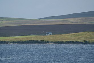 Hascosay - House on Hascosay, with the hills of Fetlar beyond