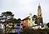 Houses and a church tower in Portmeirion (2004).jpg