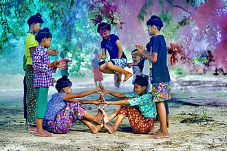 "Hpan Khone - Children of Set Set Yo Village in Myanmar demonstrating the fifth and final round of Hpan Khone, or ""High Jump Game.""  This traditional game is played by children in Myanmar.  A similar game called Luksong tinik is played by Filipino children."