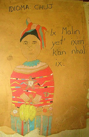 Chuj people -  Chuj folk art: a Chuj woman with text in the Chuj language alluding to Maya corn culture