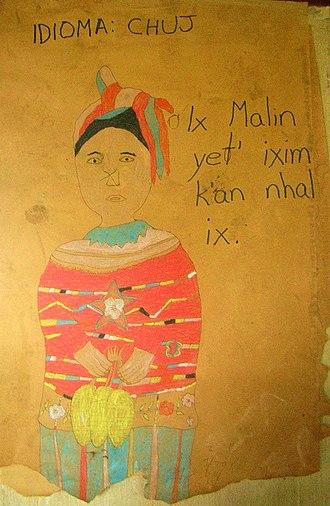 Chuj people -  Chuj folk art: a Chuj woman with text in the Chuj language alluding to Maya corn culture