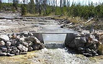 Irving Friedman - Hydrologic monitoring at Tantalus Creek, Yellowstone National Park, photo by Irving Friedman