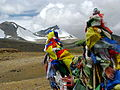 India - Ladakh - Trekking - 101 - prayer flags and glaciers atop 5440m Yalang Nyau pass (3895806257).jpg