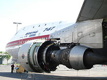 The Pratt & Whitney JT9D turbofan suspended under the wing pylon of the 747 prototype. It is stripped of its outer casing, revealing the engine's core at The Museum of Flight in Seattle, WA