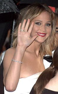 Jennifer Lawrence is waving to the camera.