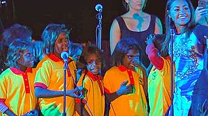"The Sapphires (film) - Mauboy performing ""Ngarra Burra Ferra"" at the 2013 Mbantua Festival in Alice Springs, Northern Territory with Aboriginal Australian students from Yipirinya State Primary School, of which Mauboy is the official ambassador."
