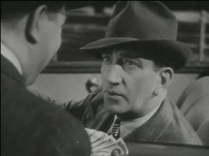 John Litel - John Litel in the trailer for Little Miss Thoroughbred (1938)