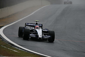 Kazuki Nakajima - Nakajima driving in the rainy first free practice session during the 2007 Brazilian GP. His father Satoru also made his Formula One debut at the Brazilian GP in 1987.