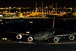 Ken H. THA A340-500 taxiing for spot. (5318584730).jpg