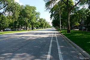 Chicago park and boulevard system - King Drive has two medians with trees planted in them. Parking is allowed on the side streets but not on the large central thoroughfare.