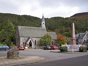 "Dugald Buchanan - Kinloch Rannoch. The church is All Saints Scottish Episcopal Church. The obelisk is not a war memorial, but is inscribed: ""In memory of Dugald Buchanan the Rannoch schoolmaster, evangelist and sacred poet, died 24th June 1768"". The memorial is dated 1875."