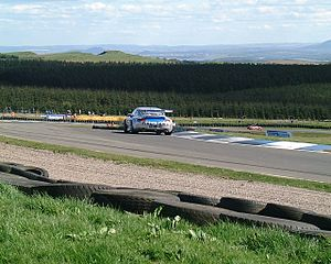 Knockhill Racing Circuit - A Porsche at the top of Duffus Dip
