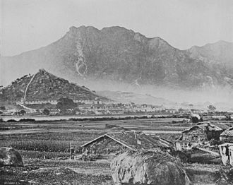 Kowloon - Kowloon c. 1868, depicting the Qing-era Kowloon Walled City and Lion Rock (in the background)