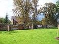 Králův Dvůr, zámek, západní zeď, dům 5. května čp. 19 a 117.jpg