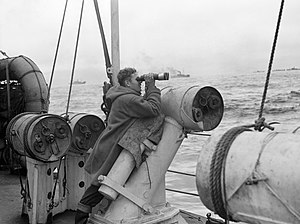 HMS Viscount (D92) - Leaning against a depth charge thrower, the quarterdeck lookout on board HMS VISCOUNT searches the sea for submarines, 1942 (IWM A13362)