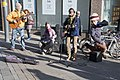 Leeds buskers with flying child (6778900751).jpg
