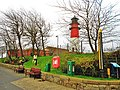 Leuchtturm -Tassenpegel-Ankerfriedhof-Bänke.jpg