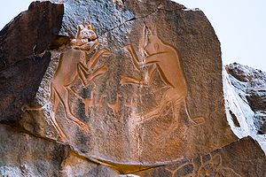 "Petroglyph - Rock carving known as ""Meerkatze"" (named by archaeologist Leo Frobenius), rampant lionesses in Wadi Methkandoush, Mesak Settafet region of Libya."