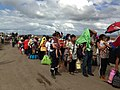 Lines of People Await Transport From Tacloban Airport to Manila or Cebu (10898598325).jpg