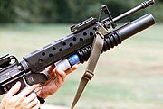Loading M203 40 mm grenade launcher attached to an M16 rifle