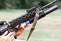 Loading M203 40 mm grenade launcher attached to an M16 rifle.jpg