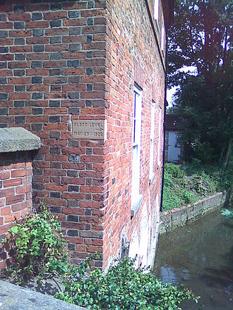 Louth, Lincolnshire - A stone plaque on Bridge Street showing the flood water level.